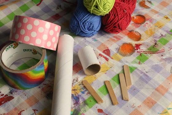 cardboard rolls, yarn, popsicle sticks