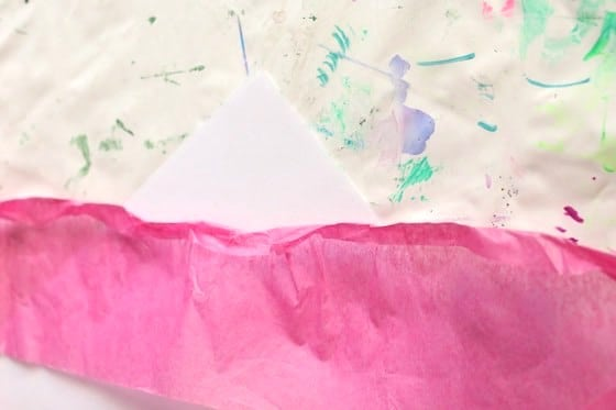 Strip of pink tissue paper folded