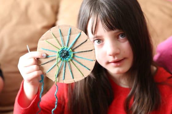 Girl holding circle weaving