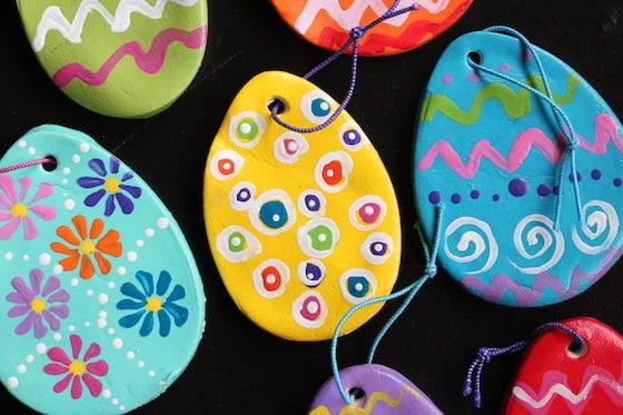 decorated claydough eggs black bckgorund horizontal