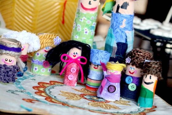 paper towel dolls wrapped in fabric and yarn