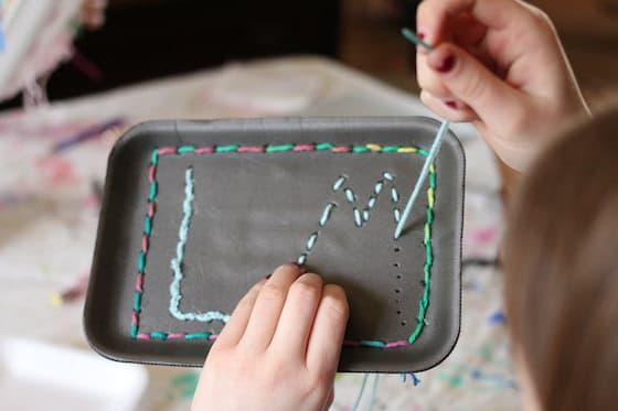 sewing practice - sewing initials on a styrofoam tray