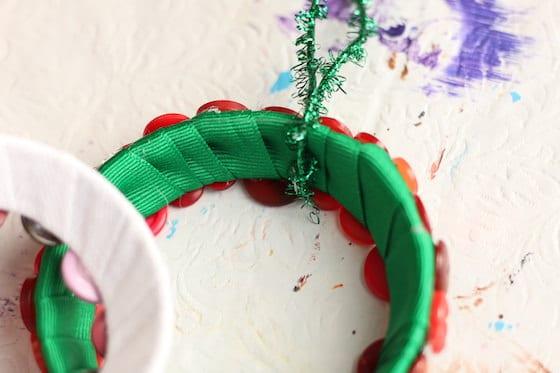 close up green ribbon wrapped around mason lid ring