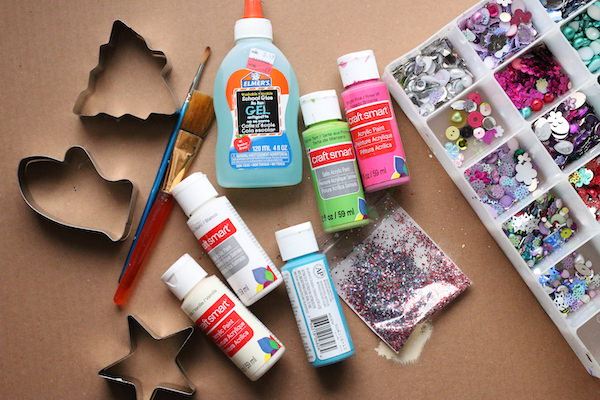 Cardboard, cookie cutters, paint, glue, glitter, sequins and craft gems