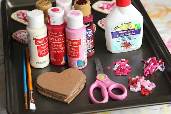 cardboard hearts, paint, glue, yarn sprinkles, pipe cleaner sprinkles, scissors