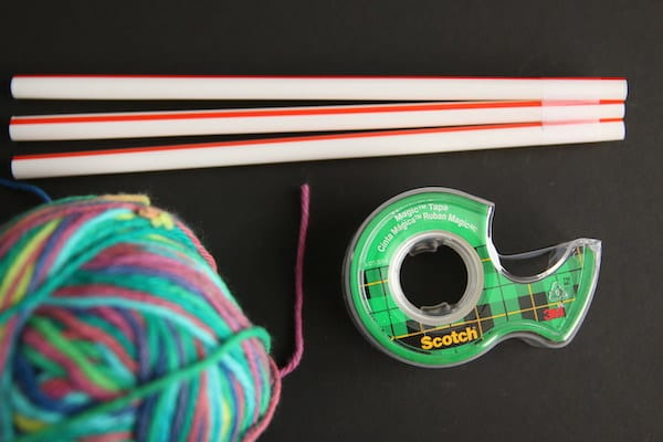 drinking straws, tape, yarn