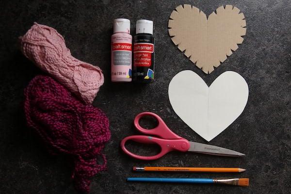 Cardboard heart, paint, yarn, scissors