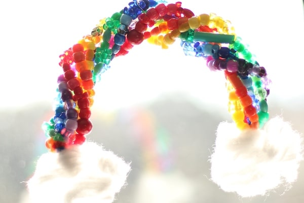 beaded pipe cleaner rainbow hanging in window