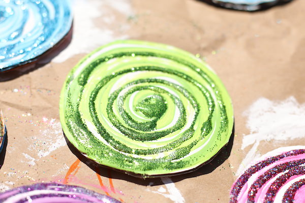 glittered swirls on cardboard lollipop