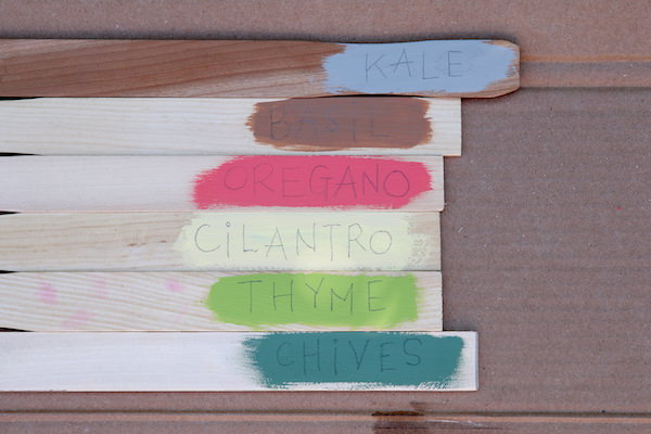 paint sticks with herb names pencilled