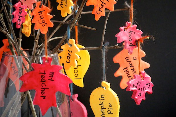 close up painted clay leaves on thankfulness tree