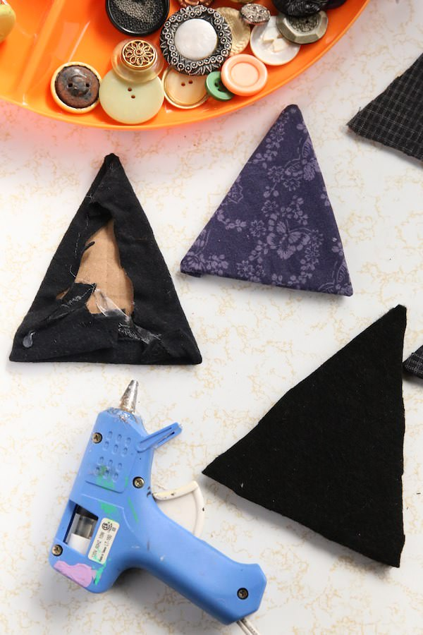 gluing fabric on cardboard witch hats