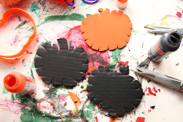notches cut into painted cardboard pumpkins