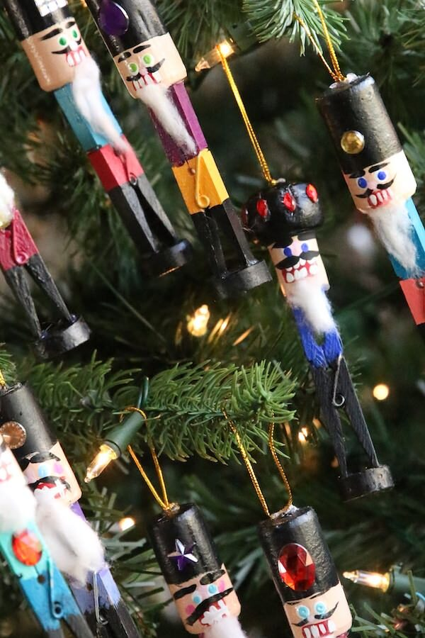 8 homemade nutcracker ornaments hung on Christmas Tree