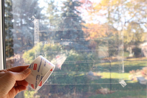 packing tape sticky canvas on window