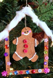 cardboard gingerbread man in craft stick gingerbread house ornament