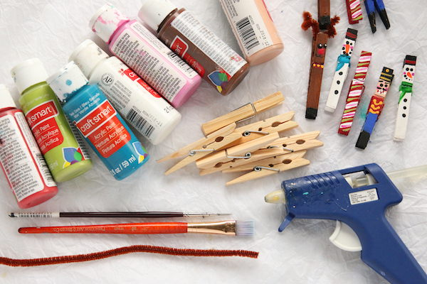 paint, clothespins, paintbrushes, glue gun, pipe cleane