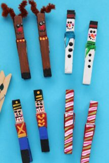 painted clothespin reindeer, snowmen, nutcrackers and candy canes on blue background