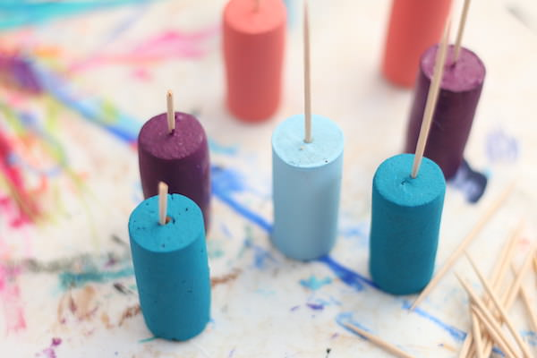 painted corks with toothpicks in tops