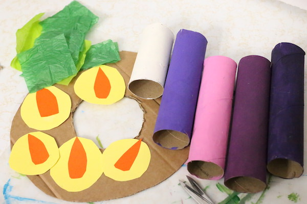tissue paper, paper flames, cardboard wreath, painted cardboard rolls