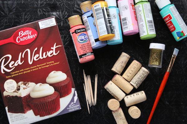 cake box, corks, paint, glitter, toothpicks, paint brushes