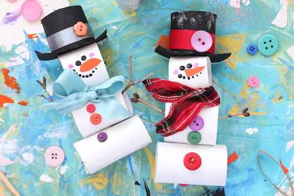 toilet paper roll snowmen on blue background